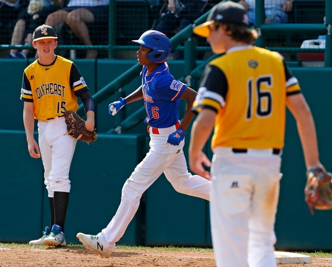 Grosse Pointe Woods-Shores's Jarren rounds first base after hitting a solo home run in the third inning of Wednesday's elimination game at the Little League World Series.