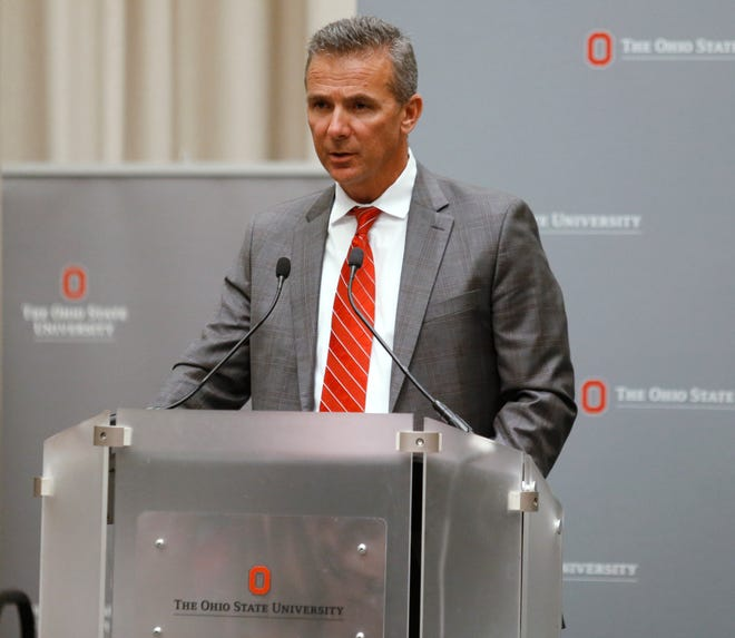 Ohio State football coach Urban Meyer makes a statement during a news conference in Columbus, Ohio, on Wednesday.
