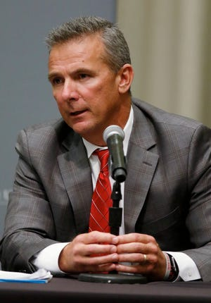 Urban Meyer answers questions during a news conference Wednesday night.
