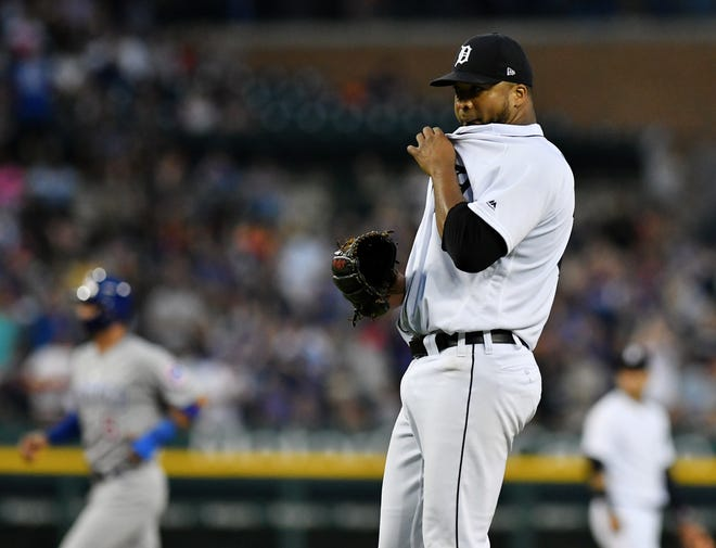 Tigers pitcher Francisco Liriano wipes off some sweat after Cubs' David Bote hit a two-run home run in the fifth inning on Wednesday.