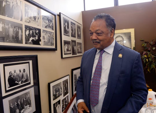 The Rev. Jesse Jackson visits the New Bethel Baptist Church history room before his sermon to the congregation on August 19.