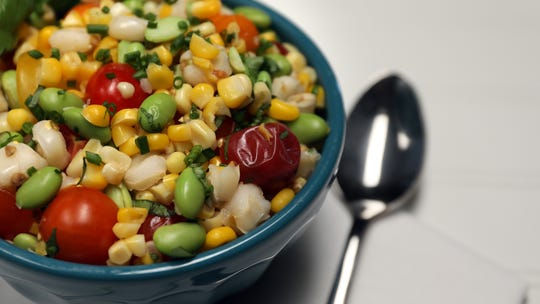 This fresh corn salad uses Peruvian corn, called choclo, which has a toothsome texture. (Terrence Antonio James/Chicago Tribune/TNS)