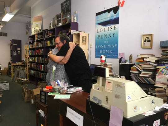"""Chris Karpo of Saline, a regular customer, hugs owner Jamie Agnew. Karpo said life goes on – but the closing is """"breaking all of our hearts."""""""