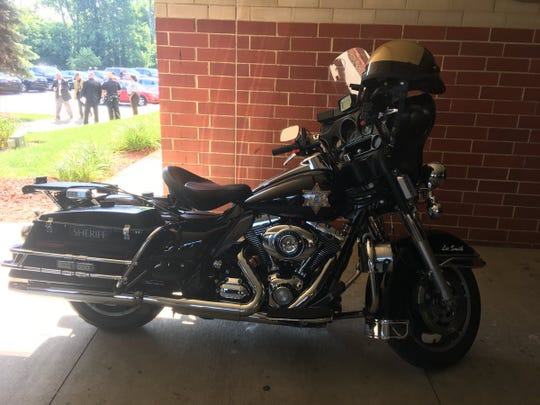 The motorcycle of Wayne County Sheriff's deputy Lee Smith, who was killed by a hit-and-run driver, on display outside Greater Grace Temple, where Smith's funeral was held Aug. 23, 2018