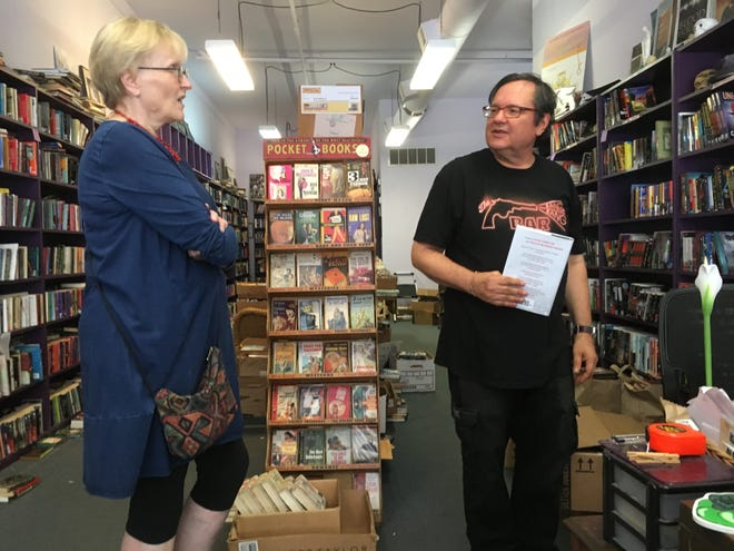 Betsy Jackson of Ann Arbor talks with co-owner Jamie Agnew while making a final shopping trip on behalf of her sister, Lynn Hammond, who lives in San Diego but visited the store every time she visited Michigan.