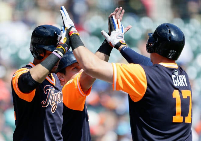 Mikie Mahtook of the Tigers, center, celebrates after scoring against the White Sox on a sacrifice fly hit by Grayson Greiner.