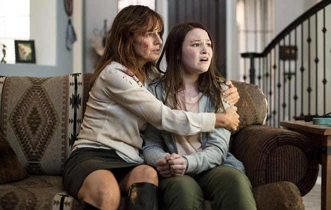 """A blood-spattered Rosemarie DeWitt, left, comforts a petrified Lolli Sorenson in the comedic thriller """"Arizona."""""""