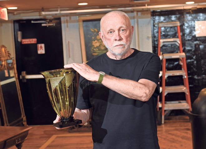 Charles Handley with his  green vase at the DuMochelles Art Galleries in Detroit on July 17, 2018.(Max Ortiz/The Detroit News)2018