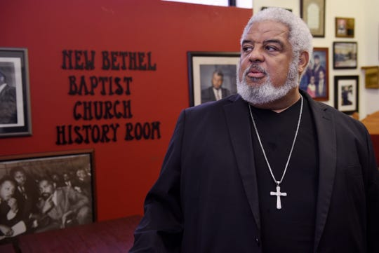 Pastor Robert Smith Jr. of New Bethel Baptist Church talks about the Franklin family inside the history room. He shares stories about the founder of the church, C.L. Franklin, and his famous daughter Aretha.
