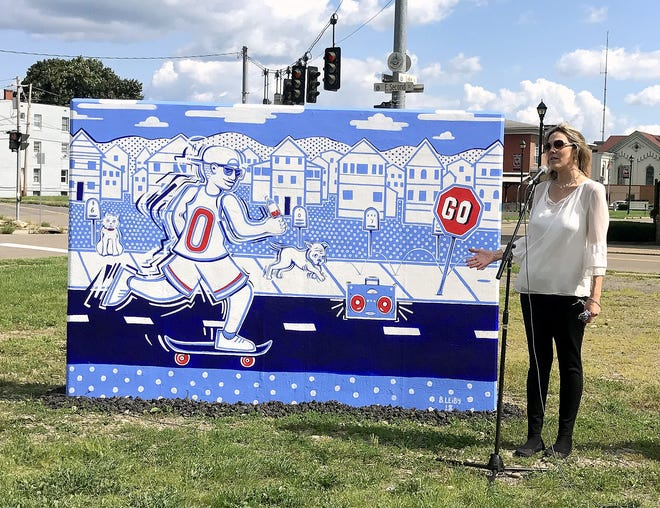Community Arts of Elmira President Lynne Rusinko talks Thursday about a recently completed mural that is part of the organization's effort to create more public art displays in the City of Elmira.