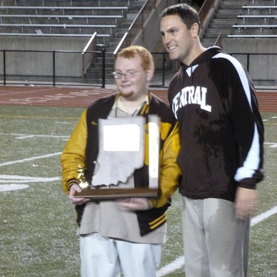 Neil Wilkins poses with Andy Owen following Central's 2011 sectional championship victory.