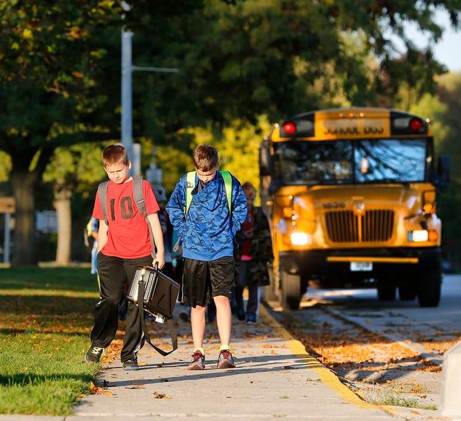 Kids getting off a school bus in Waupun.