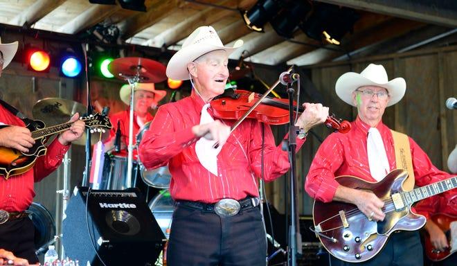 The Sleek Brothers Band performs at the Sandusky County Fair on Thursday.