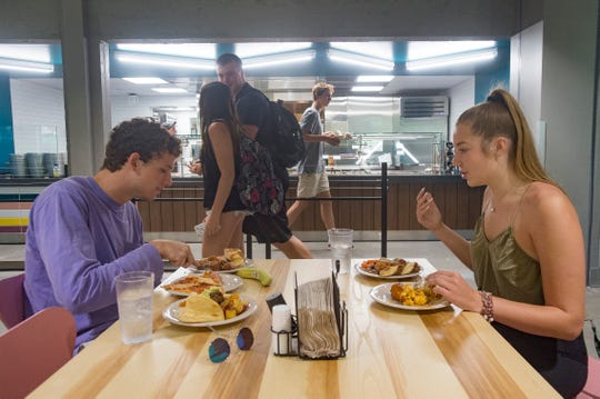 James Berger and Millie Everhart eat lunch at The Foundry dining hall at CSU on Thursday, August 23, 2018. The new concept, attached to Corbett Hall, features eight different restaurants serving menus that include international cuisines and sustainable food options.