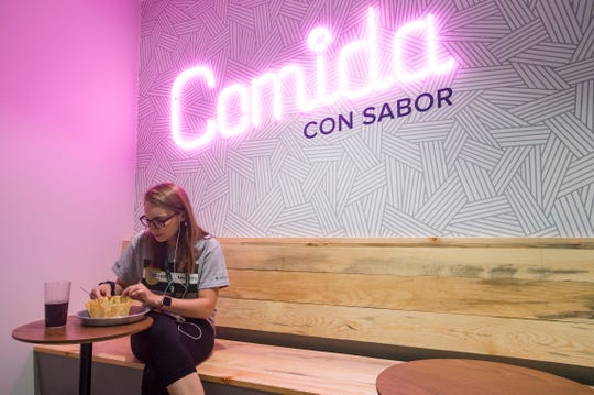 Mika Braddy eats a taco salad from Comida con Sabor, a restaurant located within The Foundry dining hall at CSU on Thursday, August 23, 2018. The new concept, attached to Corbett Hall, features eight different restaurants serving menus that include international cuisines and sustainable food options.