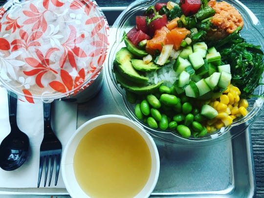 A poke bowl from Ye's Poke Station featuring tuna and salmon.