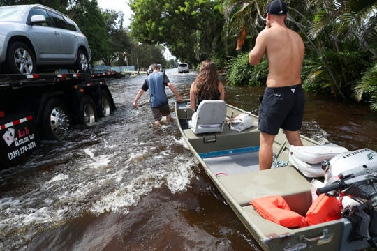 Island Park residents make thier way down Island Park drive during heavy flooding in August of 2017,