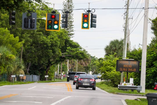 A sign warns drivers that there are schools up ahead. Many kids walk to two schools nearby even though there is no sidewalk. Penelope Bianchi, 8, went to Fort Myers City Council on Monday asking for a sidewalk to be put in on Hanson Street from Montclaire Avenue to Cleveland Avenue.