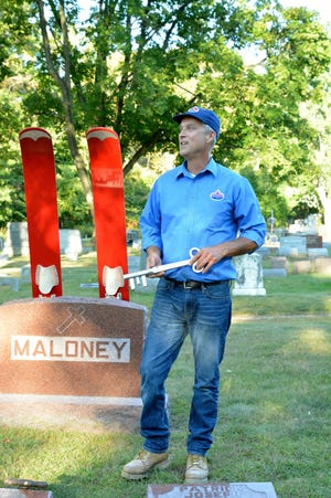 "David Retzlaff portrays Joseph J.""Red"" Maloney in the 2017 Cemetery Walk at Evergreen Cemetery. Maloney was an Oconto businessman and former Mayor. Retzlaff is holdsing the key to the city that  presented to John F Kennedy who poke at Oconto Legion Golf Course in 1960 on his campaign for president."
