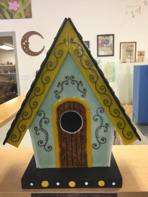 One of the 30 birdhouses decorated by Door County artists for the Sept. 1 Vintage Home & Garden Fair