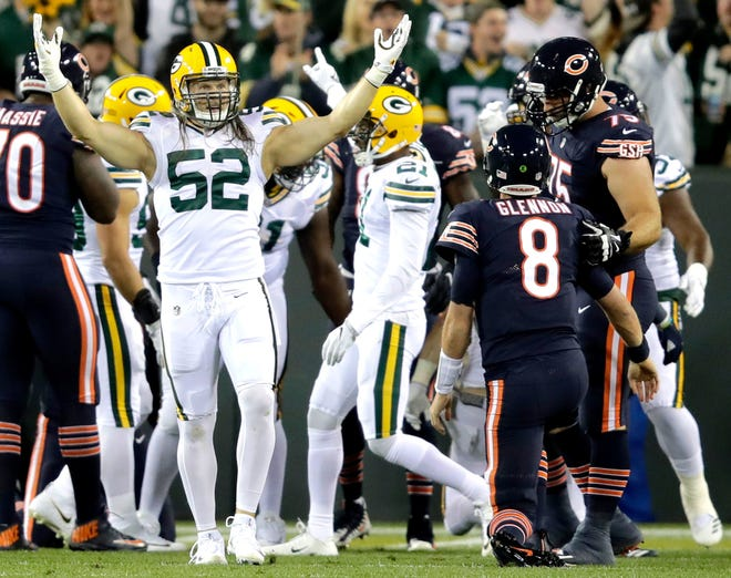 Packers linebacker Clay Matthews (52) celebrates after his sack of Bears quarterback Mike Glennon (8), which led to a fumble recovery for the Packers. It was Matthews' 75th career sack, which set the team's all-time record.