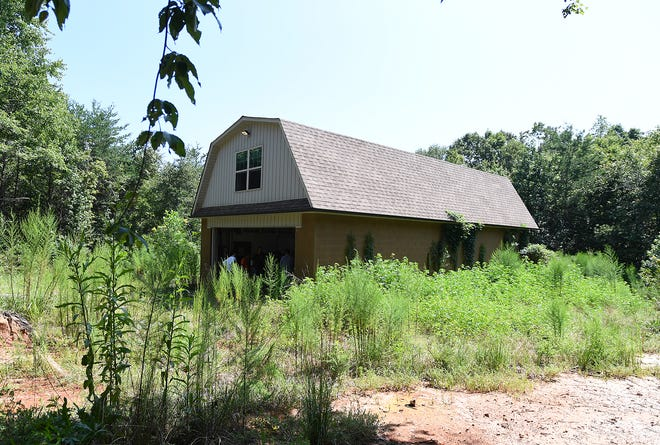 The house on Todd Kohlhepp's property on Wofford Rd in Woodruff Thursday, August 23, 2018. Items on the property are being auctioned off.