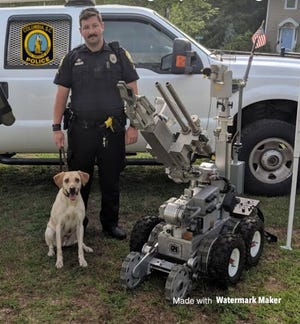 Turbo, a 2-year-old yellow Labrador Retriever who specialized in explosive detection, passed away on July 28.