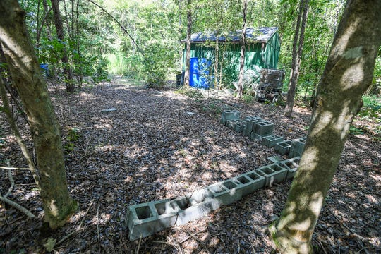 The area on Todd Kohlhepp property on Wofford Rd in Woodruff Thursday, August 23, 2018 where the storage container that held Kala Brown sat. Items on the property are being auctioned off.
