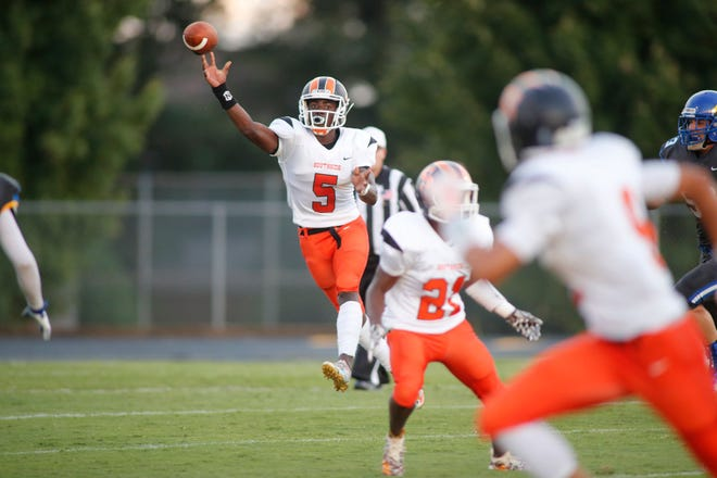 Senior quarterback Jalon Calhoun (5) and the Southside Tigers will host J.L. Mann Friday night. Calhoun accounted for 313 yards and two touchdowns last week against Eastside.
