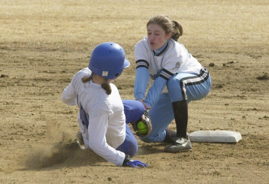 Great Falls High shortstop  Megan Schmitz tags out a Billings Skyview runner during a 2002 game at Multi-Sports Complex.