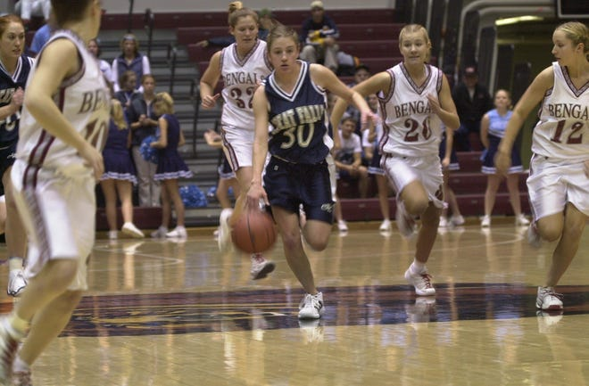 Great Falls High's Megan Schmitz drives downcourt in the 2001 State AA tournament against Helena High in Missoula.