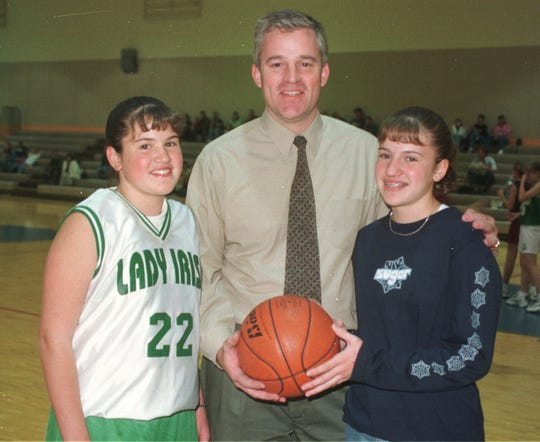 Longtime basketball coach Jerry Schmitz posed for a photo 20 years ago with his basketball-playing daughters Megan, right, and Michela. At the time Megan was a ninth-grader and Michela was an eighth-grader.