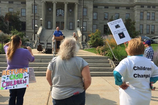 """John Schmidt, a pastor, of Helena speaks  Thursday at the """"Our kids cry too"""" rally in Helena."""