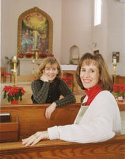 Our Lady of Lourdes principal Sherri Schmitz, right, and Holy Spirit principal Linda Traxinger posed for a photograph in 1999.