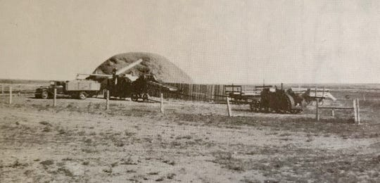 Threshing on Ira Ritenour's place near Pendroy before the farm got a combine.