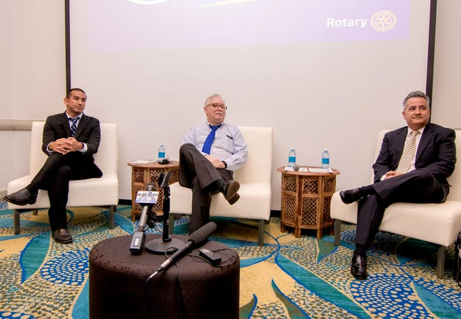 The three candidates for attorney general, from left, Leevin Camacho, Gary Gumataotao, and Doug Moylan, listen to a question during a forum held by the Rotary Club of Guam at the Outrigger Guam Beach Resort on Aug. 23.