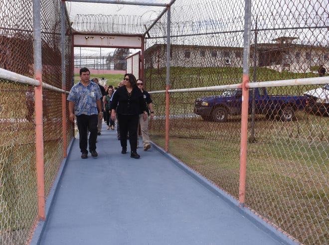 U.S. District Court of Guam Chief Judge Frances Tydingco-Gatewood, right, and Department of Corrections Deputy Director James McDonald prepare to enter Post 6, the maximum security unit, at the Mangilao prison facility on Thursday, Aug. 23, 2018.