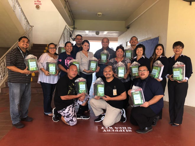 Great National Insurance Underwriters  donated school supplies to all third grade students of Tamuning Elementary on August 13. Welcome back Whales! Pictured in back from left: Eric Bamba, Tricia Cruz, Janiel Jose, Richard Seidler, Michelle Masnayon, John Fernandez, Guam DOE superintendent, Principal Josephine P. Fontbuena, Paulo Hermosilla, Vilma Bumagat, Alyssa Cabrera, Krishna Montano, Vicente Francisco, Linno Roxby and Jarett Asuncion.