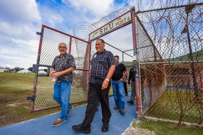 Department of Corrections Director Alberto Lamorena V, front, Robert James McIntosh and others exit Post 6, the maximum security unit, at the Department of Corrections in Mangilao after a walkthrough tour conducted on Thursday, Aug. 23, 2018.
