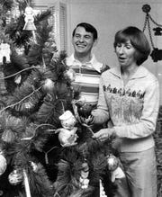 Carl DeLong and his wife Sandy prepare for Christmas Dec. 16, 1978 just two months after he lost his leg during a bombing in Speedway.