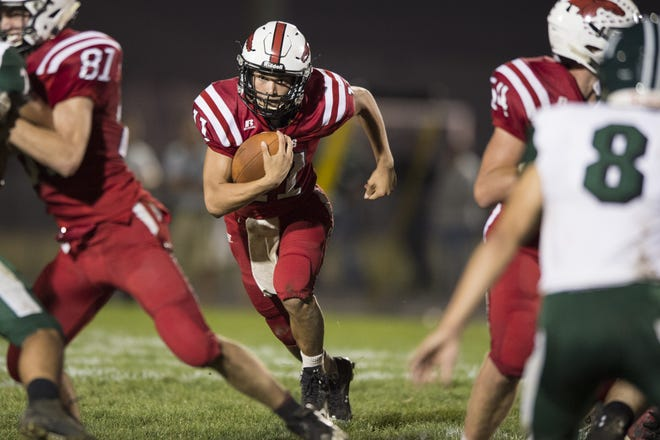 FILE – New Palestine's Zach Neligh was 9-for-10 passing last week for 172 yards and two touchdowns in a win over Kokomo.