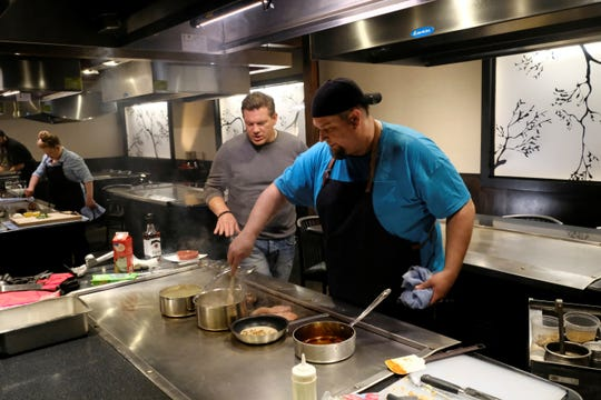 Host Tyler Florence with contestant chef Robert Graham of Black Circle Brewing, as seen on Bite Club, Season 1.
