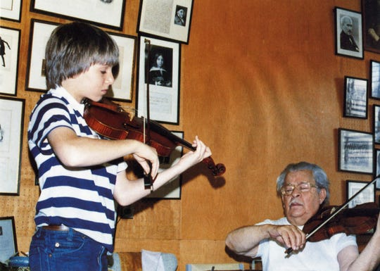 A young Joshua Bell, who has an internationally famous career, played with legendary violinist Josef Gingold for this undated photo.