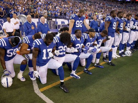 Some Indianapolis Colts chose to kneel during the national anthem before a game at Lucas Oil Stadium in Indianapolis on Sept. 24, 2017.