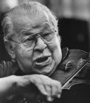 Josef Gingold, the longest known owner of the Martinelli Stradivarius, is shown playing it here in 1988.