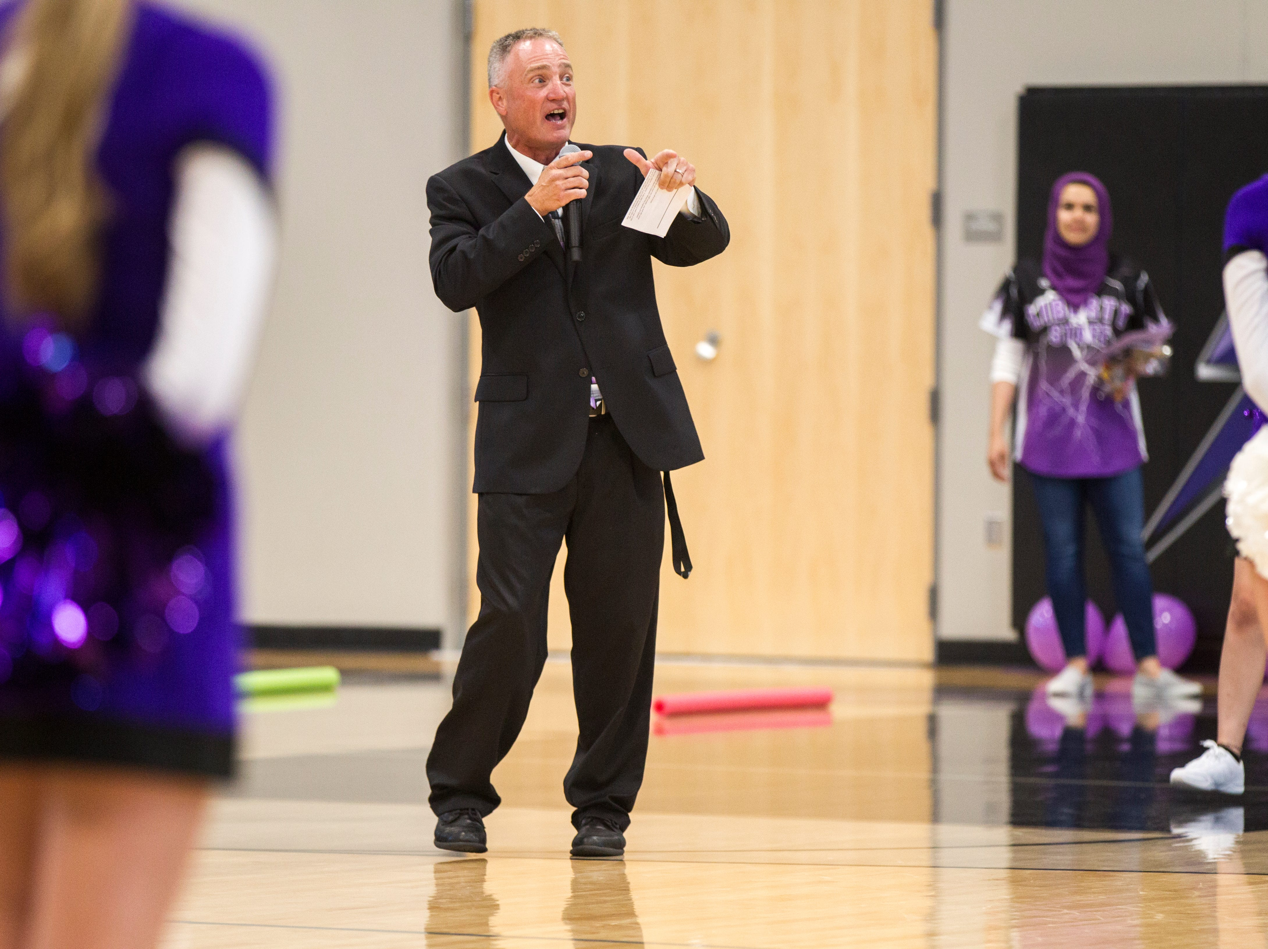 Scott Kibby, Liberty principal, speaks during a first day of school assembly on Thursday, Aug. 23, 2018, at Liberty High in North Liberty.