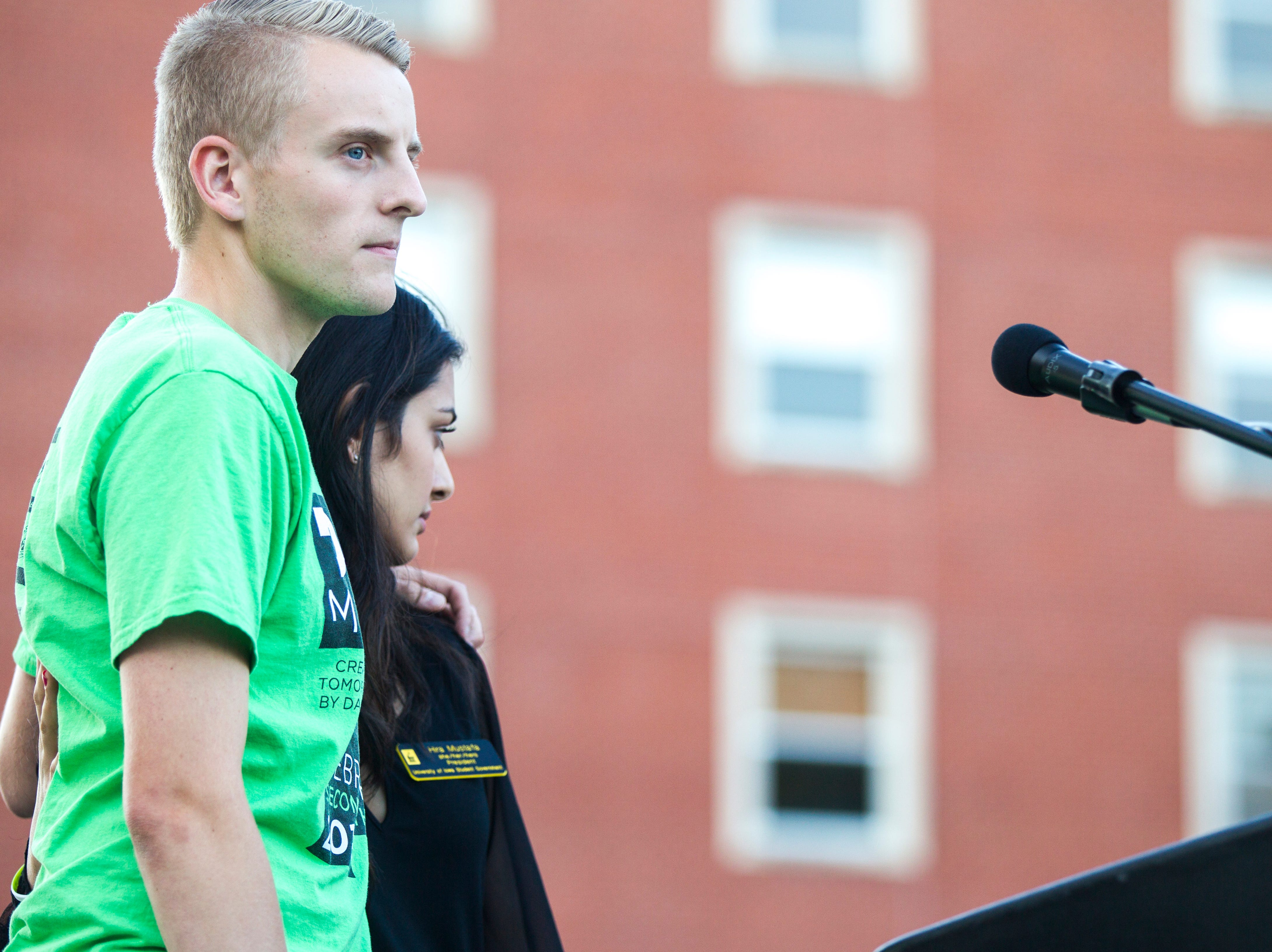 Charlie Ellis, Executive Director of Dance Marathon, embraces Hira Mustafa, University of Iowa Student Government President, during a moment of silence at a vigil for Mollie Tibbetts on Wednesday, Aug. 22, 2018, in Hubbard Park on the University of Iowa campus in Iowa City.