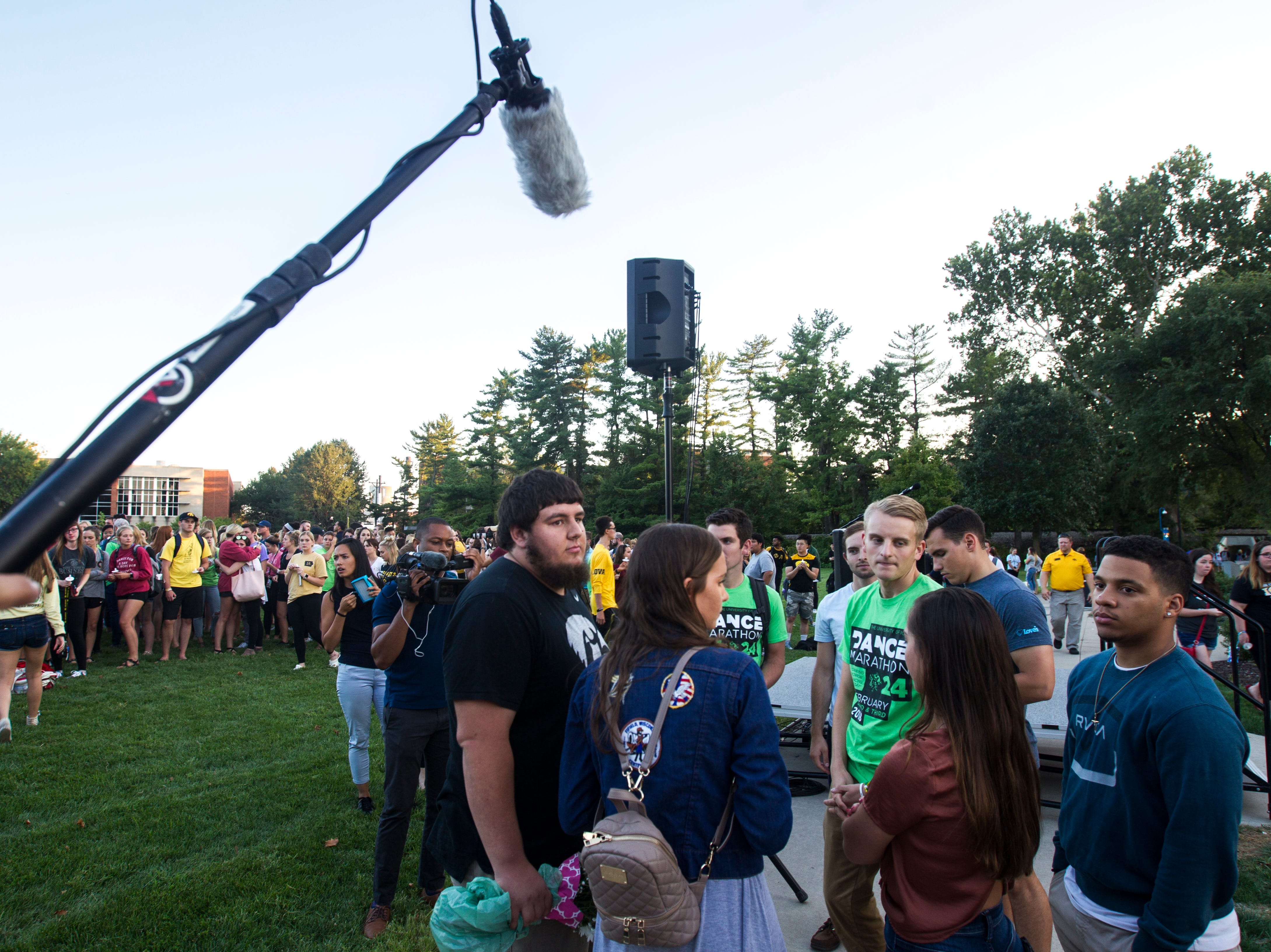 Jake Tibbetts, brother of Mollie Tibbetts, talks with supporters after a vigil for Mollie Tibbetts on Wednesday, Aug. 22, 2018, in Hubbard Park on the University of Iowa campus in Iowa City.