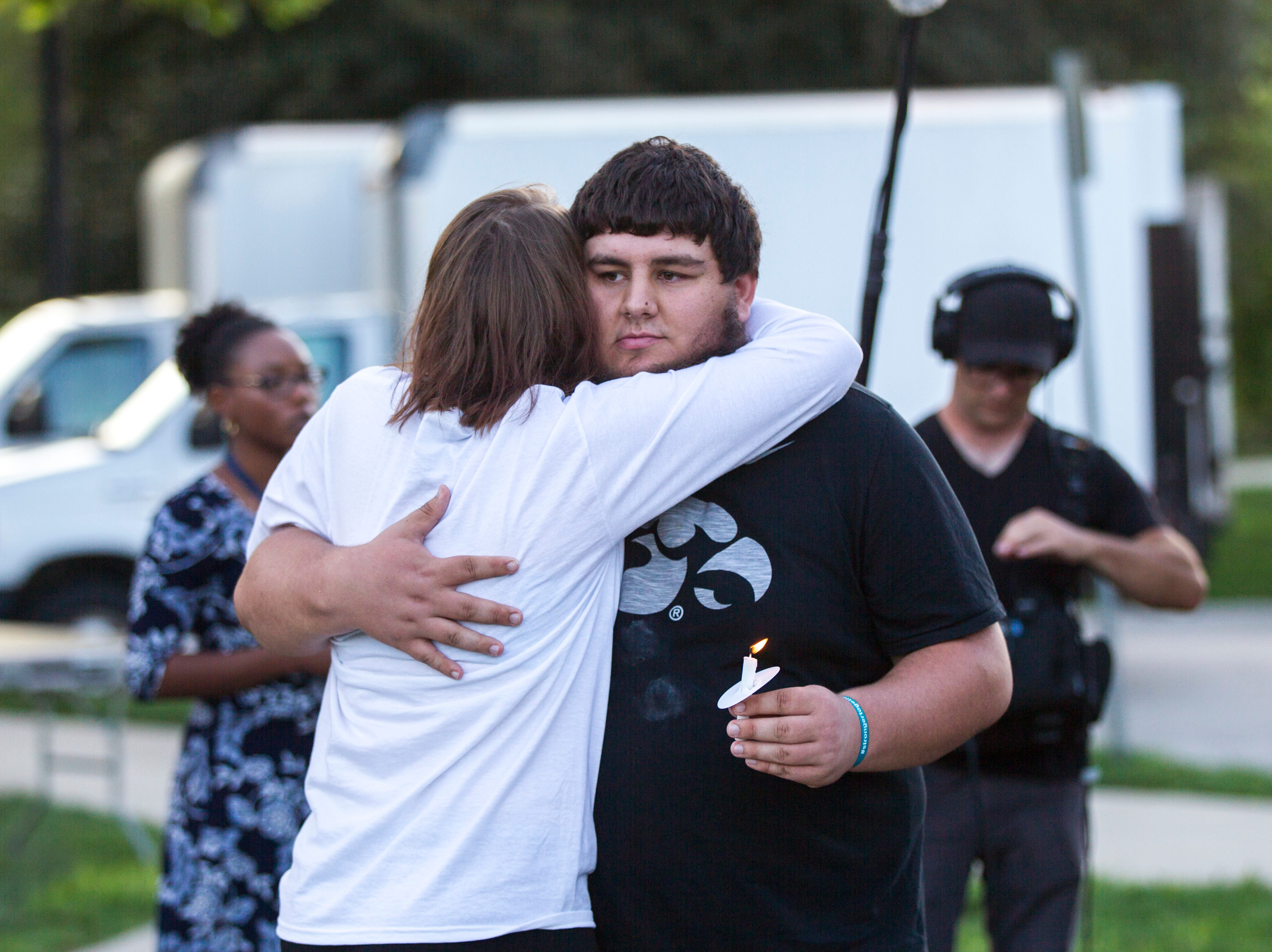 Breck Goodman embraces Jake Tibbetts, the brother of Mollie Tibbetts, during a vigil for Mollie Tibbetts on Wednesday, Aug. 22, 2018, in Hubbard Park on the University of Iowa campus in Iowa City.