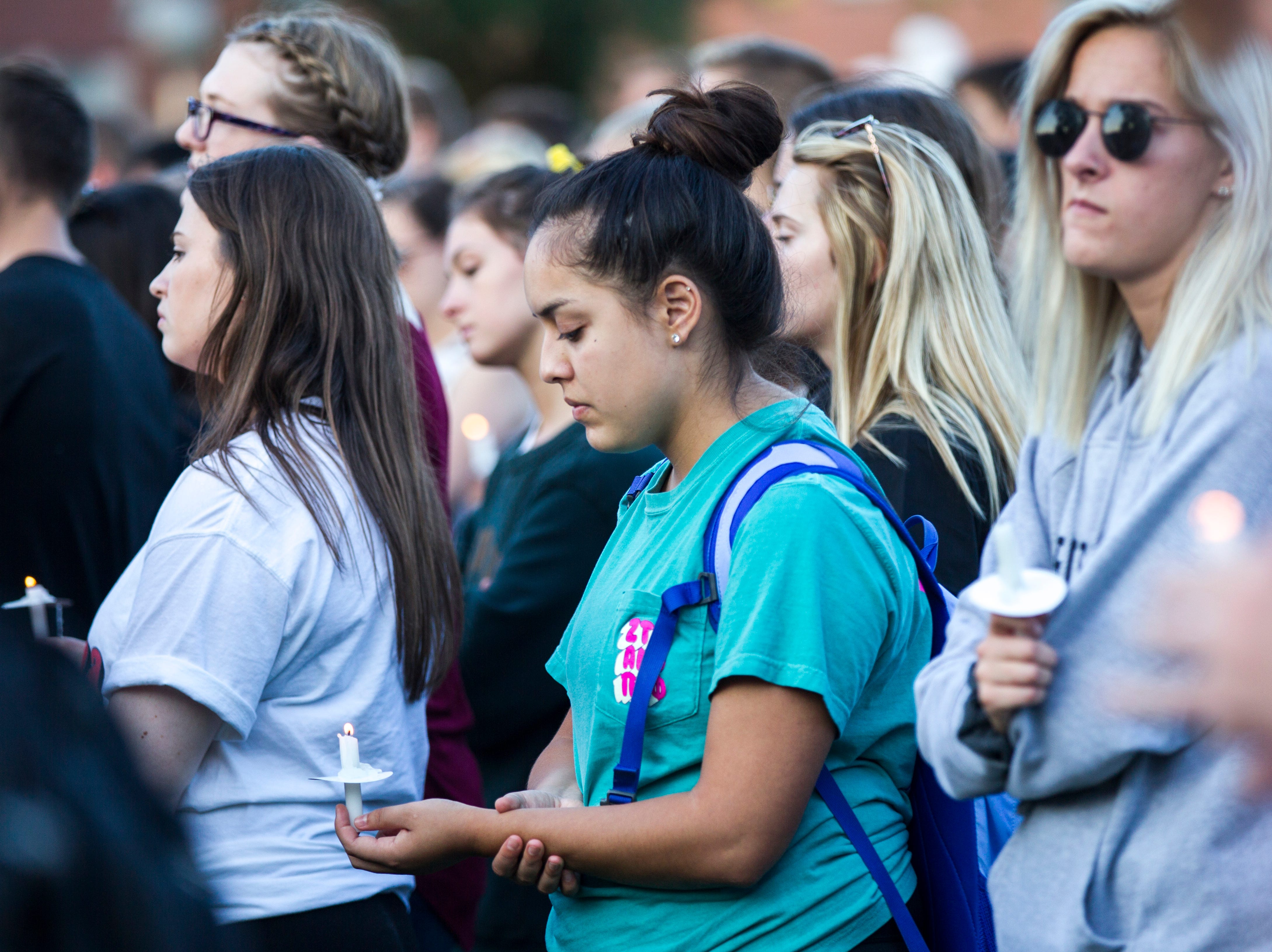 Supporters hold candles during a vigil for Mollie Tibbetts on Wednesday, Aug. 22, 2018, in Hubbard Park on the University of Iowa campus in Iowa City.